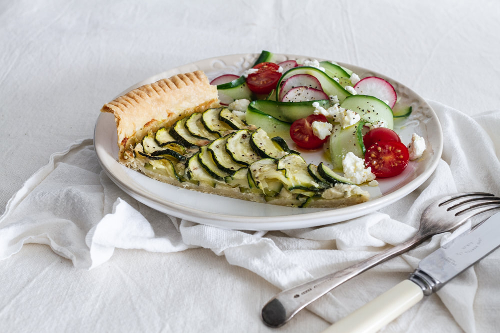 A delicious and seasonal summer recipe for courgette, mustard and gruyere cheese tart.